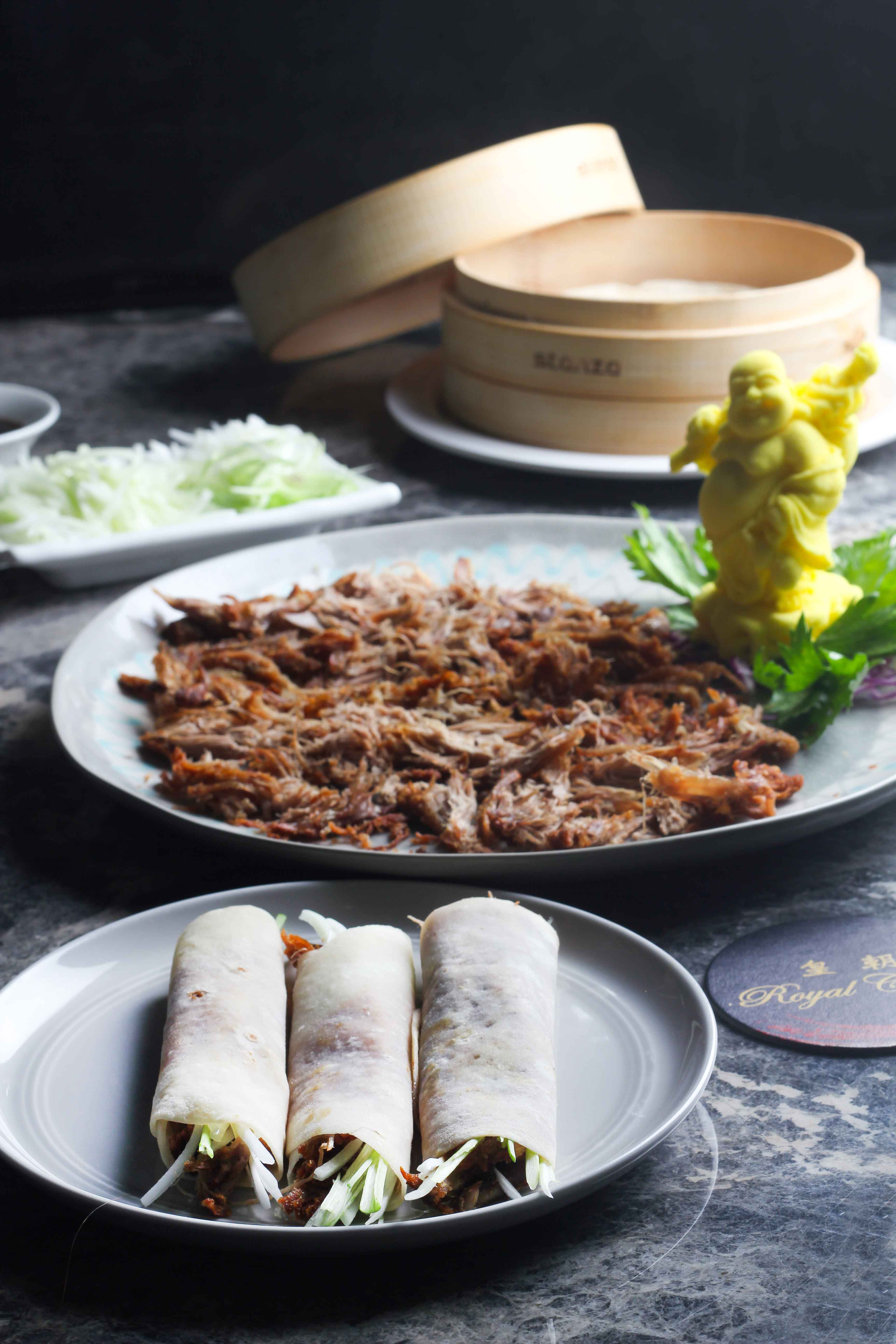 Crispy-Aromatic-Duck-served-with-spring-onion,-cucumber-and-Pan-cakes